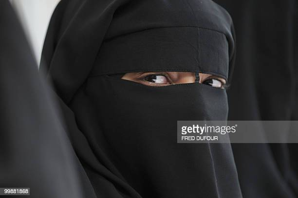 A Muslim woman wearing the niqab poses during a meeting with Imam Ali El Moujahed on May 18 2010 in Montreuil outside Paris The French parliament...