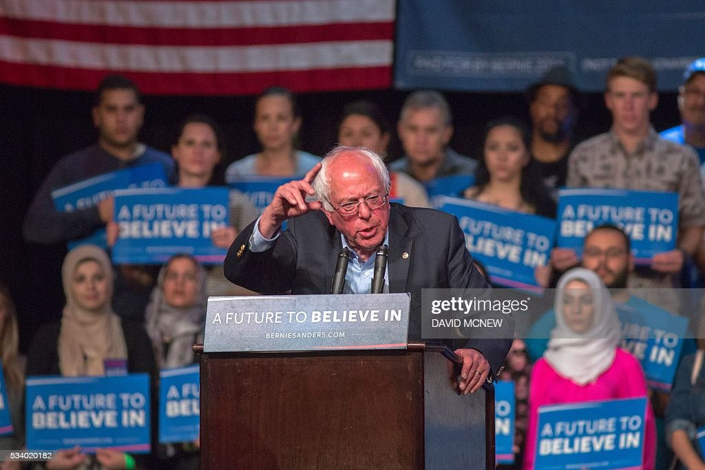 Muslim woman who support Democratic presidential candidate Bernie Sanders listen as he addresses a campaign rally at the Riverside Municipal Auditorium on May 24, 2016 in Riverside, California. US presidential candidates have turned their attention to campaigning in earnest for the June 7th California primary election. / AFP / DAVID