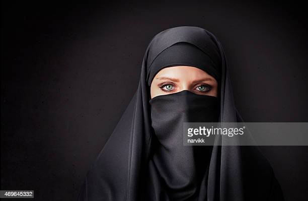Muslim woman with traditional black veil