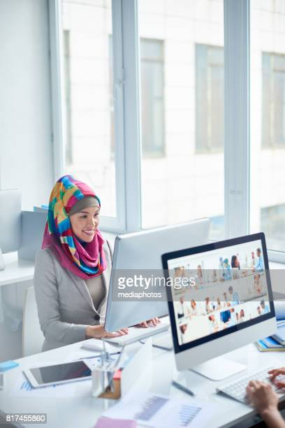 Muslim woman working as office manager
