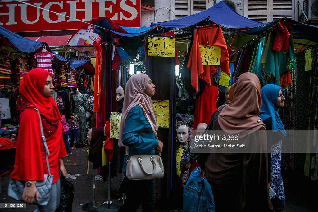 A Muslim womans is seen try to find their clothes ahead of the Eid al-Fitri festival on July 1, 2016 in Kuala Lumpur, Malaysia. Southeast Asia's Muslims are observing the fasting month of Ramadan, Islam's holiest month, during which observant believers fast from dawn to dusk. Malaysia Muslims spend extra on food and new clothes for Eid al-Fitr, the most important festival in Islam, which marks the end of Ramadan spending seems to be holding up in Malaysia and in neighbouring Indonesia, which together account for about 14 percent of the world's Muslims.