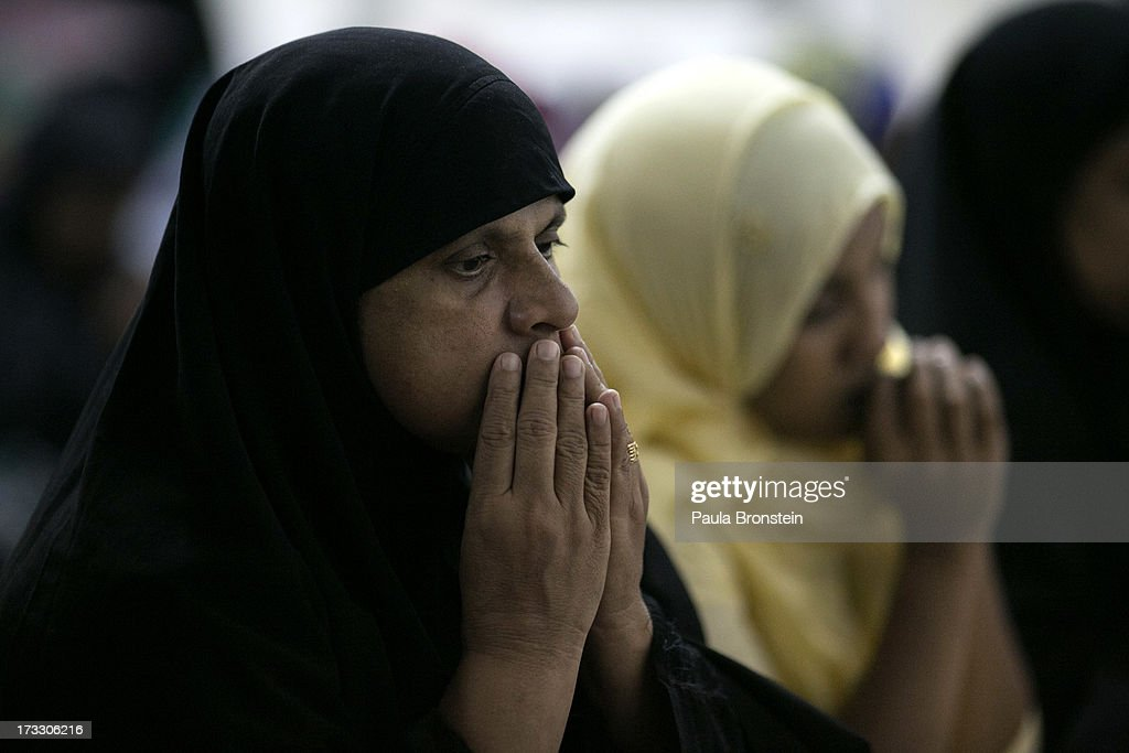 Muslim women and children attend a special evening Ramadan prayer at the Juma Masjid July 10, 2013 in Colombo, Sri Lanka. The ninth month of the Islamic calendar is observed as a month of fasting by Muslims across the globe. In Sri Lanka there are three distinct groups making up the Muslim community; the Sri Lankan Moors, the Indian Muslims and the Malays. Women in Sri Lanka are under pressure by the Budhist activist group, the Bodu Bala Sena to not wear the wear the traditional niqab.
