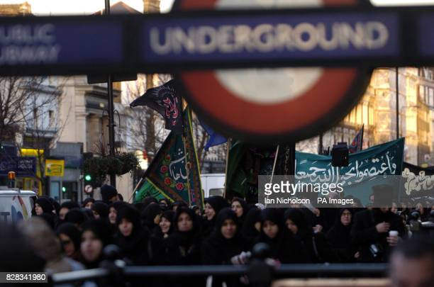 Muslim women pass through Bayswater during a march across west London Thursday February 9 the 10th day of Muharram which commemorates the death of...