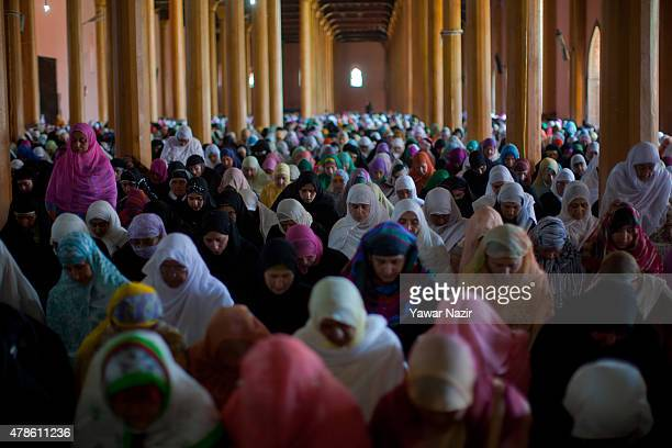 Muslim women pray inside the the Grand Mosque during the holy month of Ramadan on June 26 in Srinagar the summer capital of Indian administered...