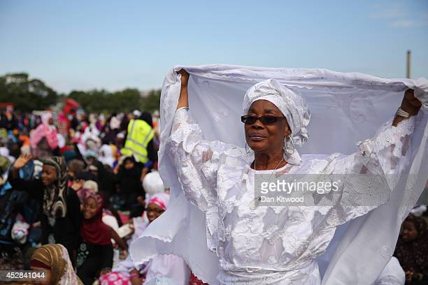 Muslim women prepare for their morning prayers ahead of an Eid celebration in Burgess Park on July 28 2014 in London England The Muslim holiday Eid...