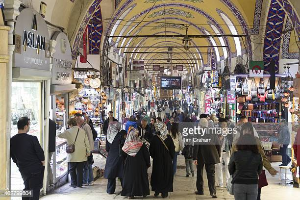 Muslim women shopping and tourists in The Grand Bazaar Kapalicarsi great market Beyazi Istanbul Republic of Turkey