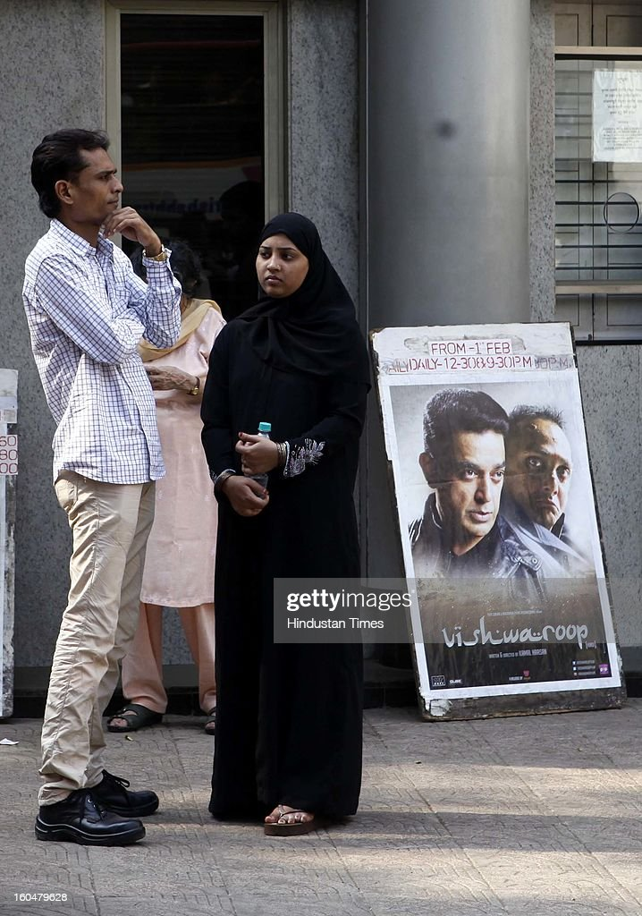 A muslim women standing outside a Bandra Theatre where Kamal Haasan's film 'Vishwaroopam' was released amid high security on February 1, 2013 in Mumbai, India. ,Vishwaroopam' is banned in Tamil Nadu with some Muslim groups taking objection to certain scenes in the movie as hurting their religious sentiments.