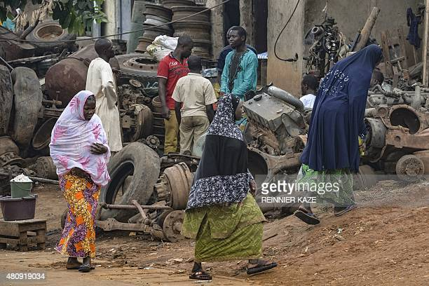 Muslim women walk in the Brituetterie district of Yaounde on July 16 2015 A northern region of Cameroon which has suffered frequent attacks by the...