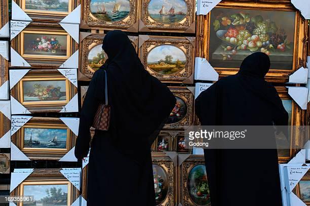 Muslim women wearing burqa shopping in London