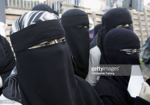Muslim women wearing niqabs veil protest outside Bangor Street Community centre where Leader of the House of Commons Jack Straw is holding one of his...