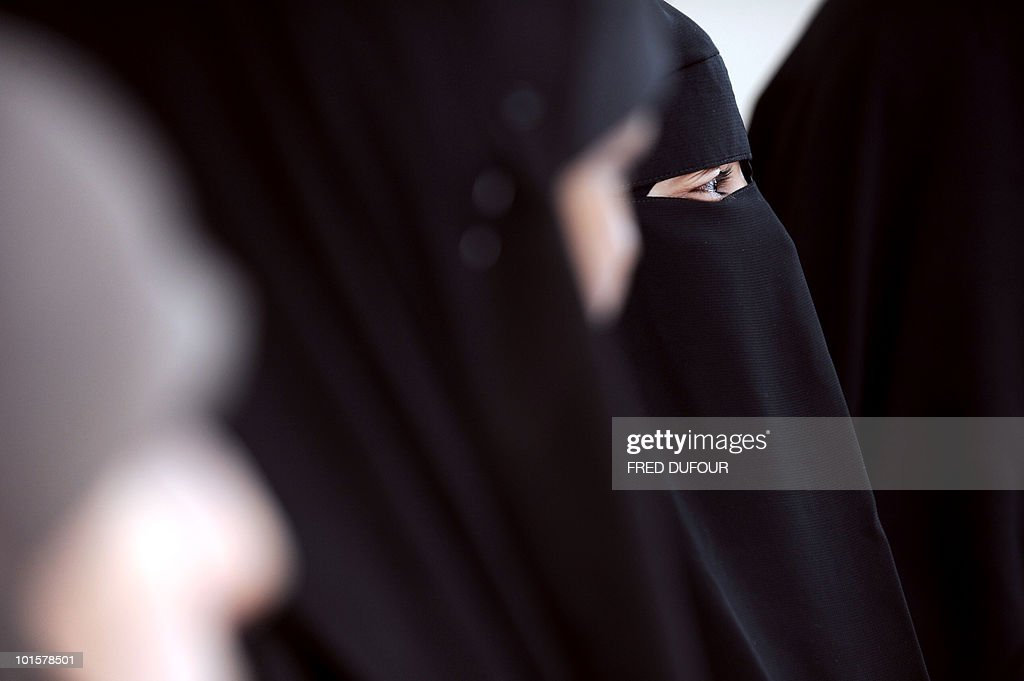 Muslim women wearing the niqab (veil which covers the body and leaves only a small strip for the eyes) participate in a meeting with Imam Ali El Moujahed on May 18, 2010 in Montreuil, outside Paris. The French parliament unanimously adopted on May 11, 2010 a resolution condemning the full-face Islamic veil as an affront to the nation's values.