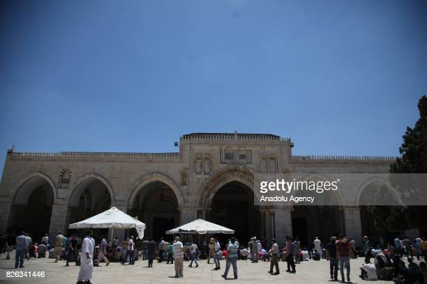 Muslim worshipers arrive for Friday Prayer at alAqsa Mosque compound after lifting of Israeli restrictions on AlAqsa in Jerusalem on August 4 2017