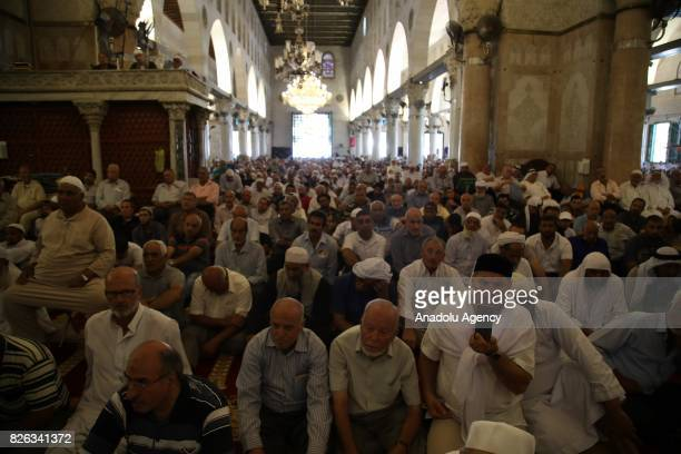 Muslim worshipers listen Friday sermon at Al Aqsa Mosque after lifting of Israeli restrictions on AlAqsa in Jerusalem on August 4 2017