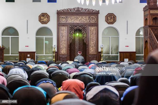 Muslim worshipers perform prayer on Laylat AlQadr in the Muslim holy fasting month of Ramadan at Emir Sultan Mosque in Dandenong Melbourne Australia...