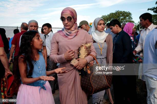 Muslim worshippers depart a group prayer service during Eid alFitr which marks the end of the Muslim holy month of Ramadan in Bensonhurst Park in the...