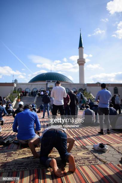 Muslim worshippers gather for Friday prayers at the IZW Viennese Islamic Center mosque two days before Austrian parliamentary elections on October 13...