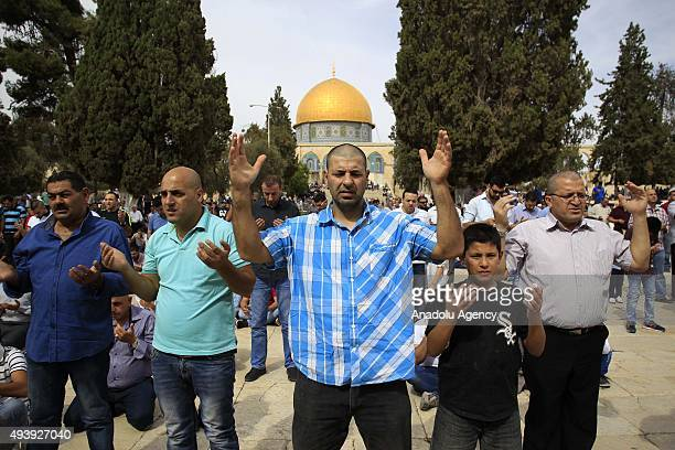 Muslim worshippers perform Friday prayer at the AlAqsa Mosque Compound after Israeli authorities remove the restriction on entering the mosque...