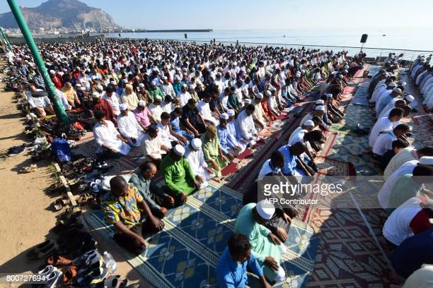 Muslim worshippers take part in the Eid alFitr prayers on the Foro Italico square in the Sicilian city of Palermo on June 25 2017 Some 1000 people...