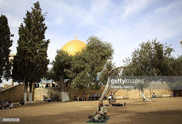 Muslim worshippers wait to perform Friday prayer at the AlAqsa Mosque Compound after Israeli authorities remove the restriction on entering the...