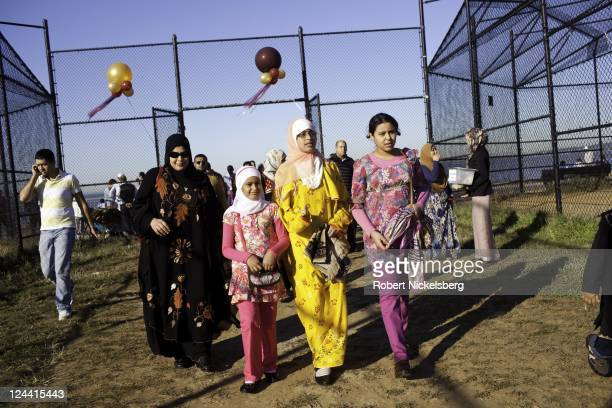 MuslimAmericans enter a public park for Eid alFitr prayers following the end of Ramadan August 30 2011 in the Brooklyn borough of New York The...