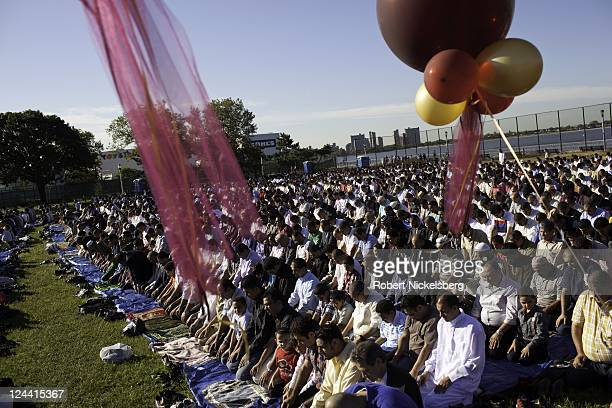 MuslimAmericans pray at a public park for Eid alFitr services following the end of Ramadan August 30 2011 in the Brooklyn borough of New York The...