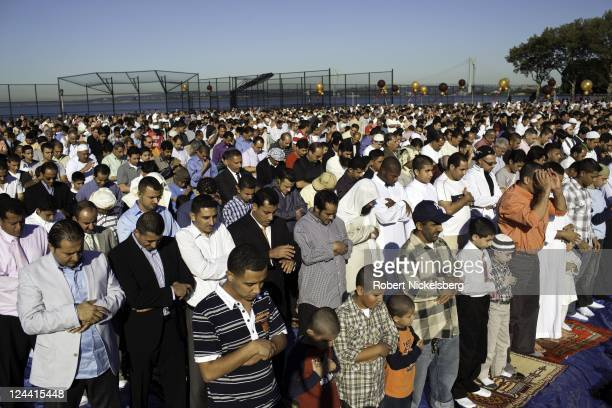 MuslimAmericans stand in rows to pray at a public park for Eid alFitr services following the end of Ramadan August 30 2011 in the Brooklyn borough of...