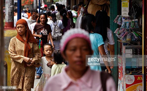 CITY PHILIPPINES – JULY 21 2009 Muslims and Catholics freely mingle on the streets of downtown Zamboanga City Philippines though relations remain...