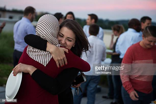 Muslims and nonMuslims guests attend an iftar dinner on a roof deck in Northeast for those who participated in fasting for Ramadan June 20 2016