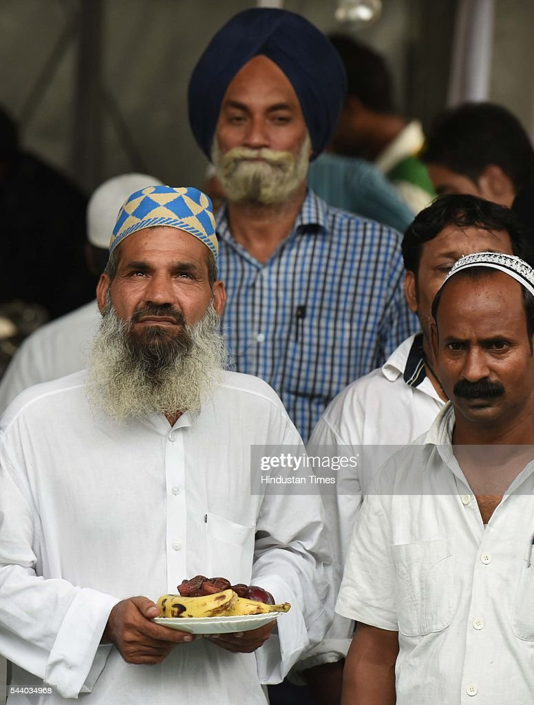Muslims and others during the Iftar party hosted by Delhi Chief Minister Arvind Kejriwal, on June 30, 2016 in New Delhi, India. In the ninth month of the Islamic calendar, Muslims worldwide observe Ramadan, a period of fasting and other rituals designed to bring self-purification through self restraint and other good deeds. The fasting begins at dawn and lasts until sunset, when observers break their fast with an evening meal called the Iftar.