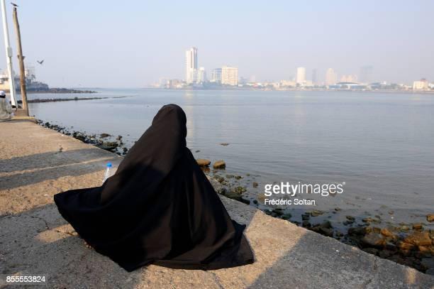 Muslims are going to Haji Ali Mausoleum in Mumbai mendicant woman on February 16 2015 in Mumbai on April 14 2010 in Mumbai India