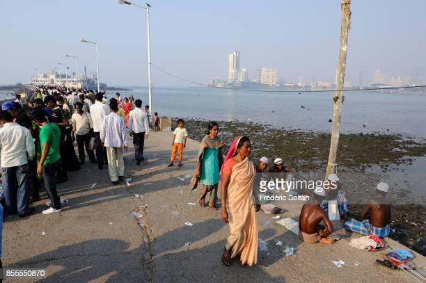 Muslims are going to Haji Ali Mausoleum in Mumbai mendicants on February 16 2015 in Mumbai on April 14 2010 in Mumbai India