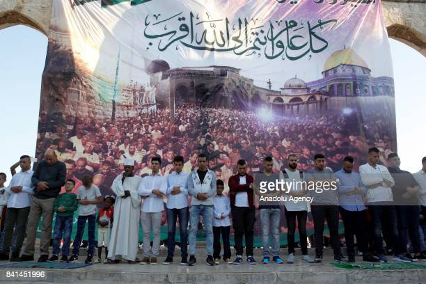Muslims arrive perform the Eid AlAdha prayer at AlAqsa compound in Jerusalem on September 01 2017 Muslims worldwide celebrate Eid AlAdha to...