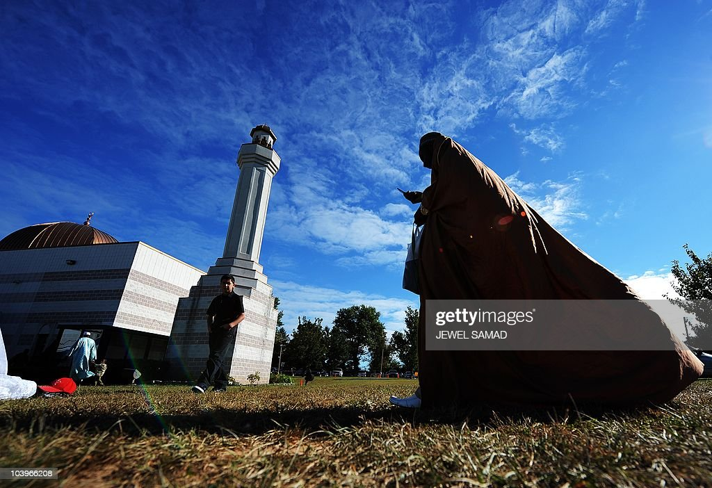 Muslims arrive to attend special Eid-al-Fitr prayer at a mosque in Silver Spring, Maryland, on September 10, 2010. Thousands of rock-pelting Afghans assaulted a NATO military outpost on September 10 as fury built across the Muslim world against a US pastor's threats to immolate the Koran on the anniversary of 9/11. In a turbulent start to the festival of Eid al-Fitr, when Muslims worldwide mark the end of the Ramadan fasting month, leaders of countries including Afghanistan and Indonesia issued dire warnings against the provocative act. AFP PHOTO/Jewel Samad