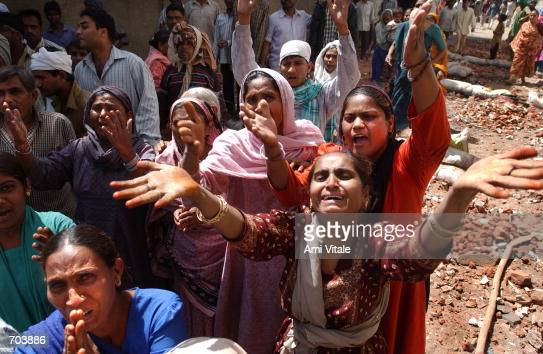 Muslims beg members of the news media and the Indian Rapid Reaction Force Police to protect them from a mob of Hindu neighbors that were attacking...