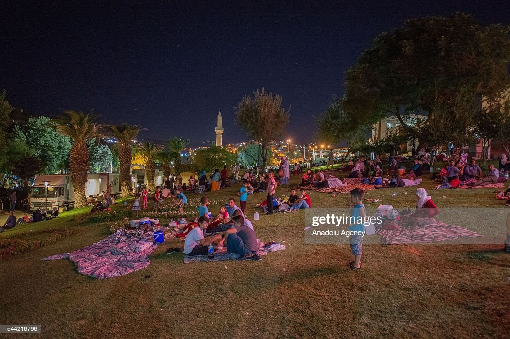 Muslims break their fast on the evening of the Laylat al-Qadr , the night when the first verses of the Quran were revealed, at Balikligol region in Sanliurfa province of Turkey on July 1, 2016.