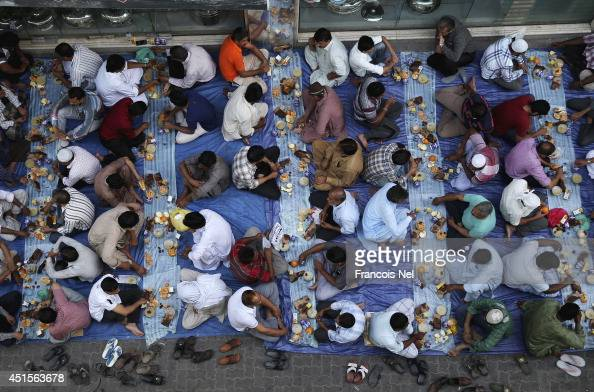 Muslims break their fast with iftar during the holy month of Ramadan at Lootha Mosque Bur Dubai on July 1 2014 in Dubai United Arab Emirates Muslim...