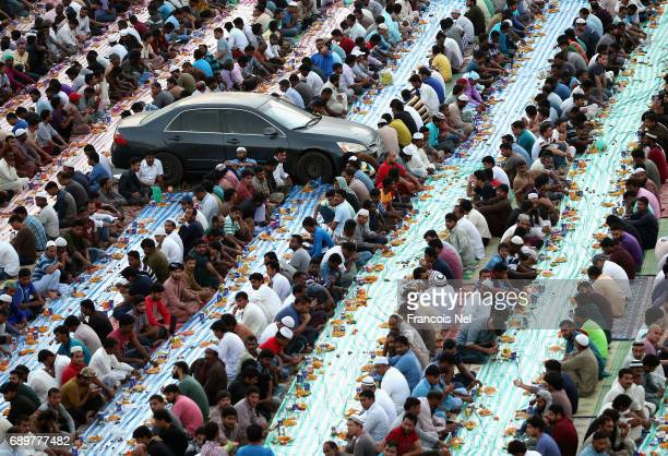 Muslims break their fast with iftar during the holy month of Ramadan on May 29 2017 in Dubai United Arab Emirates Muslim men and women across the...