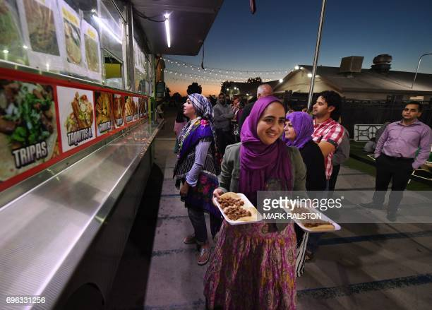 Muslims break their Ramadan fast after sunset by eating halal Mexican tacos from a food truck during a campaign called 'Taco Trucks at Every Mosqude'...