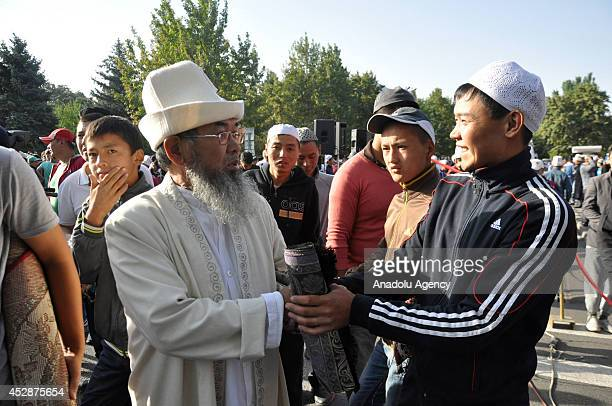 Muslims exchange greetings on the second day of Eid alFitr after Eid alFitr prayer in Bishkek Kyrgyzstan on 29 July 2014