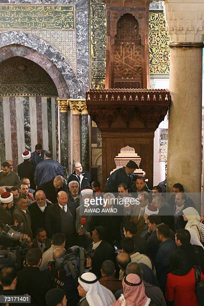 Muslims gather as the new minbar or pulpit is put into place in the AlAqsa Mosque in annexed east Jerusalem 01 February 2007 A replica of a wooden...