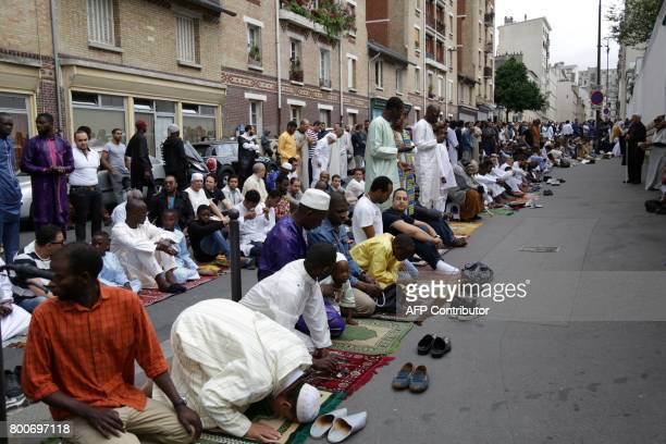 Muslims gather to offer Eid alFitr prayers outside the Grande Mosquee de Paris in Paris on June 25 2017 Eid alFitr festival marks the end of the holy...