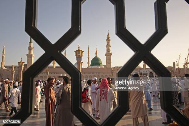 Muslims gather to perform the Eid alFitr prayer at Masjid alNabawi in Medina Saudi Arabia on June 25 2017 Eid alFitr is a religious holiday...