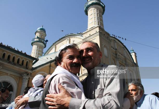 Muslims greet each other as they gather to perform the Eid AlAdha prayer at Shah E Doshamshira Mosque in Kabul Afghanistan on September 01 2017...