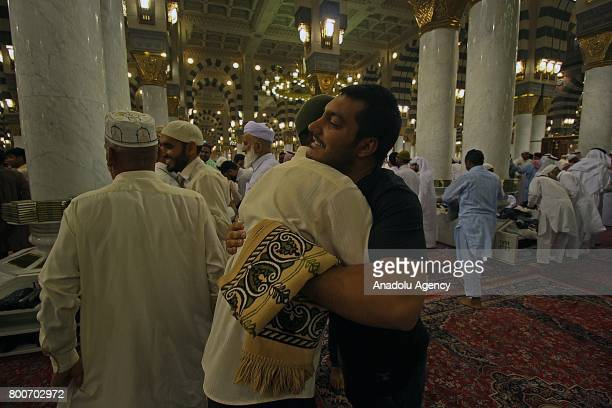 Muslims greet each other at Masjid alNabawi after performing the Eid alFitr prayer in Medina Saudi Arabia on June 25 2017 Eid alFitr is a religious...