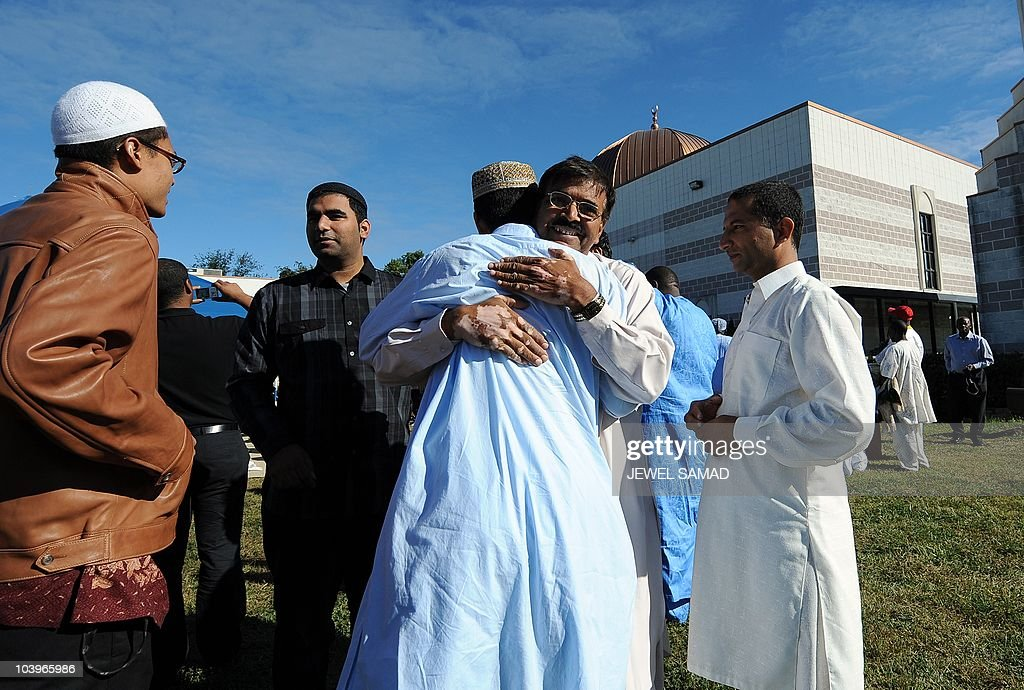 Muslims greet each others after taking part in a special Eid-al-Fitr prayer at a mosque in Silver Spring, Maryland, on September 10, 2010. Thousands of rock-pelting Afghans assaulted a NATO military outpost on September 10 as fury built across the Muslim world against a US pastor's threats to immolate the Koran on the anniversary of 9/11. In a turbulent start to the festival of Eid al-Fitr, when Muslims worldwide mark the end of the Ramadan fasting month, leaders of countries including Afghanistan and Indonesia issued dire warnings against the provocative act. AFP PHOTO/Jewel Samad
