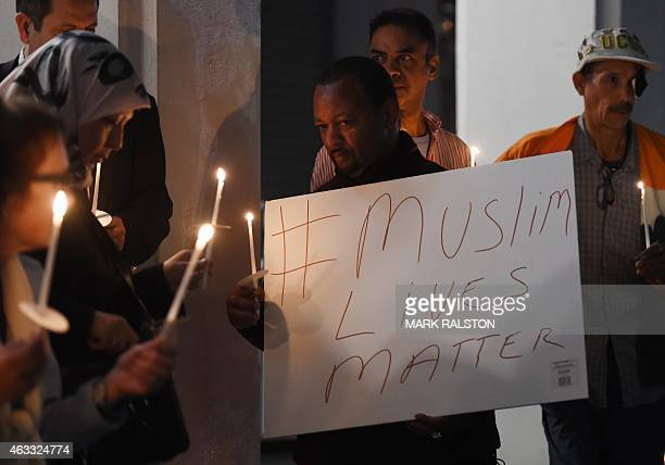 Muslims hold a candlelight vigil at the Islamic Center of Southern California in Los Angeles on February 12 2015 for the three Muslim students who...