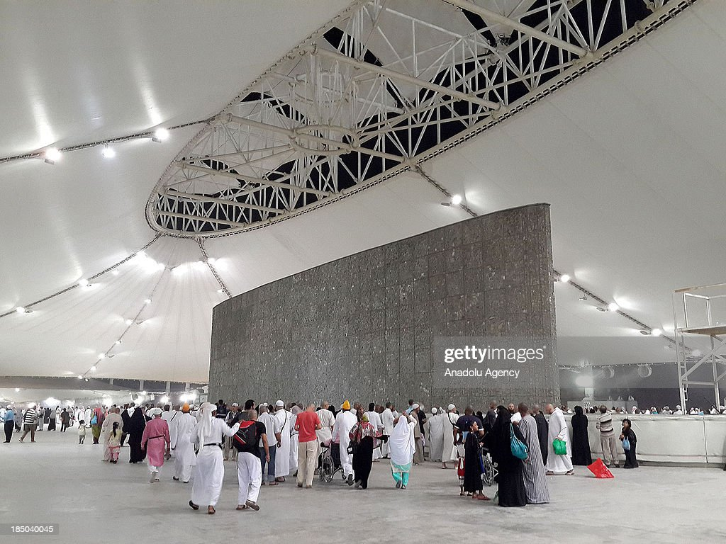 Muslims in Mecca stoning the devil, a part of the annual Islamic Hajj pilgrimage to the holy city of Mecca, on October 17 the 3rd day of Eid al-Adha in Mecca, Saudi Arabia.