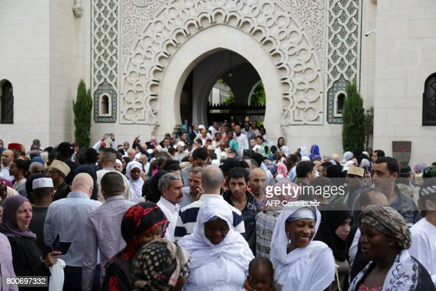 Muslims leave the Grande Mosquee de Paris in Paris after the Eid alFitr prayers on June 25 2017 Eid alFitr festival marks the end of the holy Muslim...