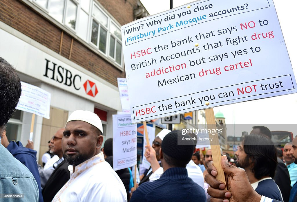 Muslims living in England gather to protest against a notice by HSBC bank to close the mosques bank account on August 16, 2014. Finsbury Park mosque, the Ummah Welfare Trust and the Cordoba Foundation have all received letters saying their accounts will be closed due to 'risk appetite'.