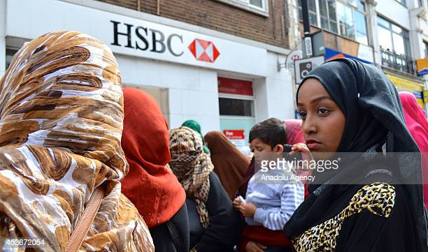 Muslims living in England gather to protest against a notice by HSBC bank to close the mosques bank account on August 16 2014 Finsbury Park mosque...